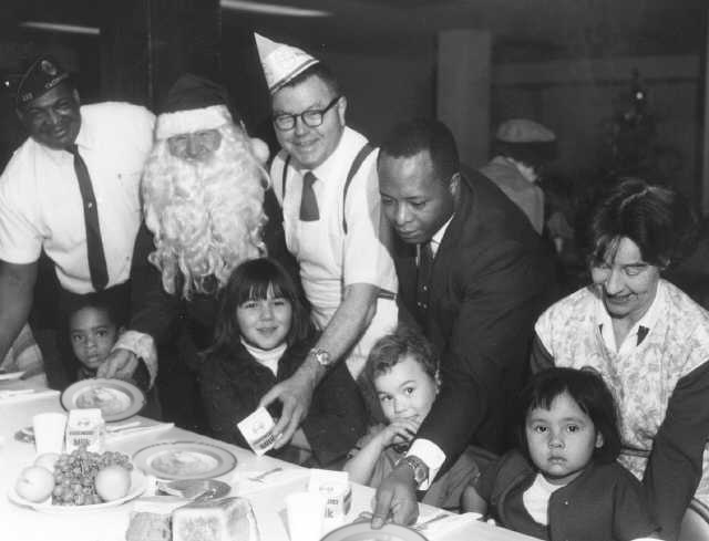 American Legion Volunteers serve Christmas Grits in 1967