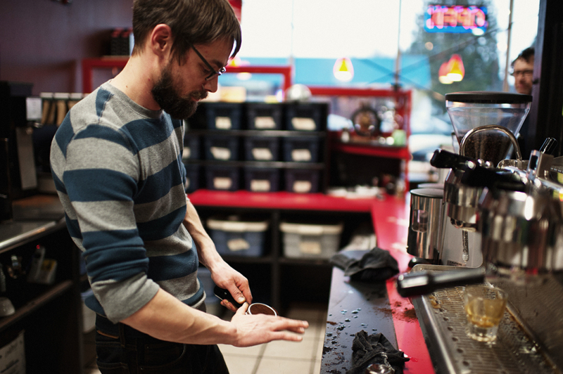 Byron Betts preps a portafilter to pull espresso shots. Betts is co-owner and roaster at Valhalla.