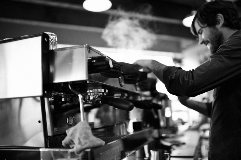 Mitchell Zollinger makes espresso and roasts at Bluebeard.