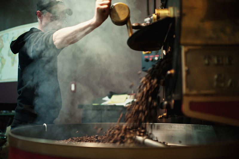 "Things move fast. Roasters look, smell and listen for the approach or arrival of the ""second crack,"" the release of oil, around which time (before, during, after), 12 to 15 minutes into the roast, the beans are dropped into the cooling tray, and the machine is prepped for the next batch."