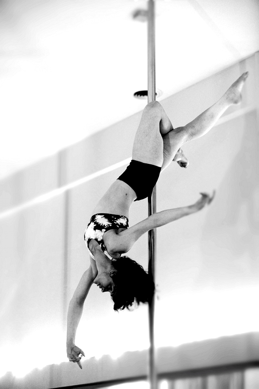 Noelle demonstrating the more acrobatic elements of pole.