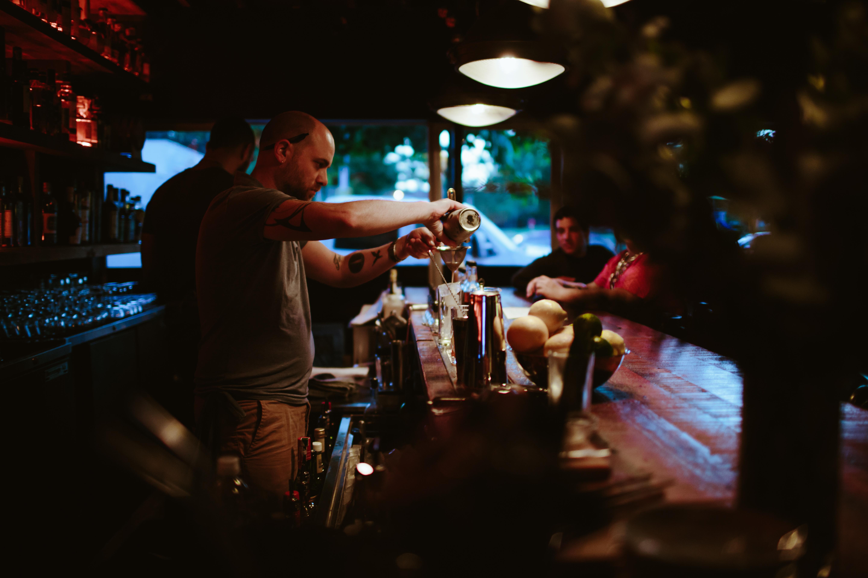 Owner Chris Keil and bartender Wendell Deuce create cocktails