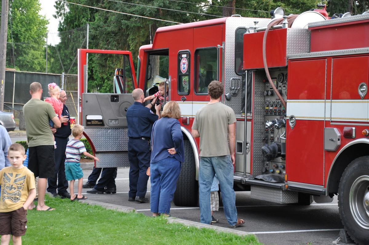 Fire fighter Ken Horsman giving a tour of Engine House 17's big red truck. From the Tacoma Fire Dept. blog.