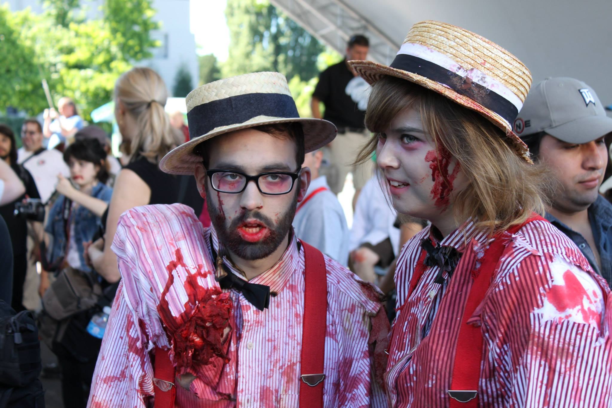 A dapper zombie couple at Crypticon's 2013 Seattle Zombie Walk.