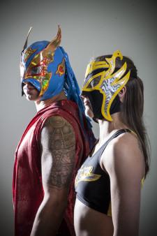 Luchador Ave Rex and luchadora Avispa of Lucha Libre Volcánica.