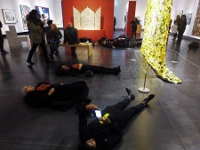 Protesters stage a die-in at the Tacoma Art Museum.